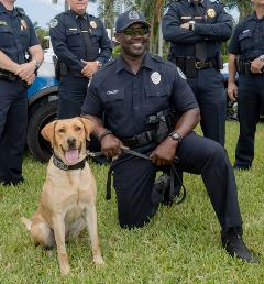 Officer Braxton McClams with K-9 partner, Gina