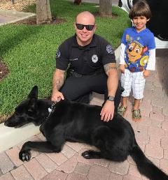 Officer Richard Duarte with K-9 partner, Apis